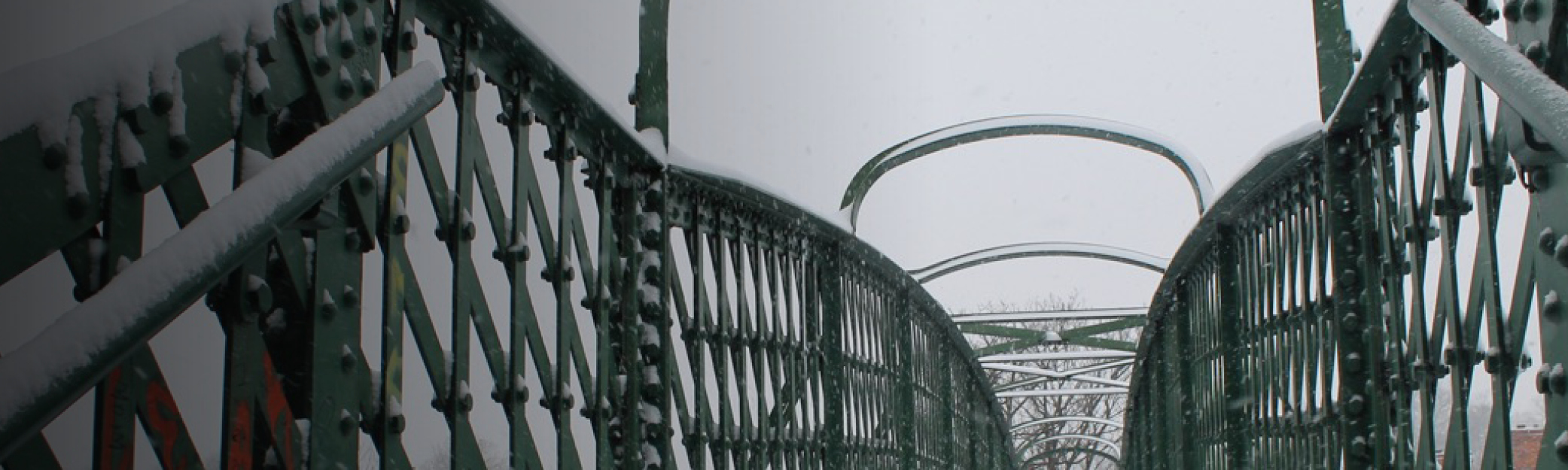 Bridge over the railway to The Dog pub in the snow